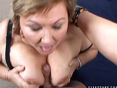 Chubby mommy with big saggy boobs is sucking meaty cock deepthroat. Then she squeezes hard stick between her succous boobs giving awesome titjob.