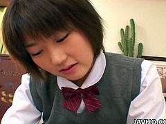 Fresh faced Japanese college student in strict uniform kneels down in front of horny group mate to suck his mini dick that barely rises in sultry pov sex video by Jav HQ.