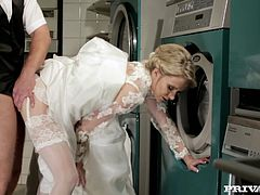 Cute blonde Angel Piaff wearing bride's dress and stockings is having fun with some guy in the laundry. She pleases him with a passionate blowjob and then they have ardent anal sex in the reverse cowgirl position.