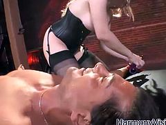 Big titted blonde slut Aiden Starr looking fucking hot in her black corset and stockings as she get nasty with a tied up man's hard baloney. Sucking and stroking it then have it balls deep inside her minge.