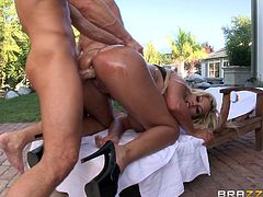 Oiled pornstar with fake tits gets buttfucked outdoors
