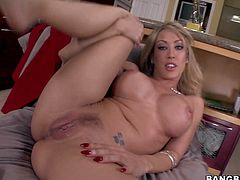 Capri Cavanni is a gorgeous pornstar with absolutely perfect body. Round boobed busty blonde with killer bubble ass strips naked and shows off her breathtaking body. Then she rubs her pink pussy.