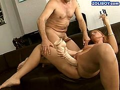 Kinky MILF with slim body is getting her anus fingered actively while pussy is pleased with small vibrator. Then, perverted guy installs huge dildo in her slit.