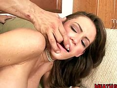 Voracious brunette porn star with gorgeous body shape is getting banged hard doggy style. The guy is squeezing her throat barely leaving air to breathe. Later she sucks meaty stick deepthroat. Busty wench also pumps dude's balls.