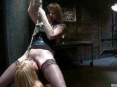 Oh, shit! That is so fucking painful. Mellanie Monroe gets chained on the wall first. Then Matiresse bondages her on the table and makes her feel sore.