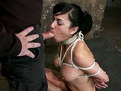 Being bondaged is not a barrier for this divine brunette sex slave. She can take that cock in her mouth and blow it deep anyway.