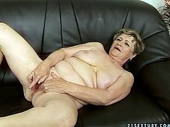 Short haired old fatso with droopy ugly boobs and big ass is fond of sucking a dick. This booty old harlot enjoys being fucked doggy too and doesn't care to get a heart attack tonight.