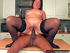 Slutty pale redhead is a horny housewife. While her husband is at work, filthy bitch in stockings pleases her neighbor right in the kitchen. Wondrous mature cowgirl enjoys being fingered and rides a strong fat cock right on the table passionately for orgasm.
