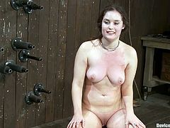 Appealing brunette Charlotte Vale allows some guy put her into irons in a basement. The dude attaches pegs to Charlie's tits and then rubs her shaved pussy with a dildo.