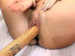 Skinny brunette fucks her juicy girlfriend with baseball bat