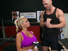 Russian babe Nikita Von James has a crush on her trainer and she ends up fucking him at the gym. He outs his huge pecker between her massive tits and thrusts back and forth. She blows him and he blows his cum on her.