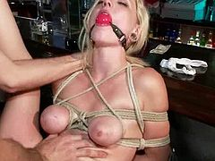Cute blonde milf is having fun with a few dudes in a bar. The men humiliate the chick and then poke their dicks into her pussy and mouth.