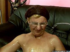 Quirky granny is pissed on after hardcore MMF threesome fuck session