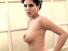 Alluring Sunny Leone is gorgeous and amazing while playing with her big tits
