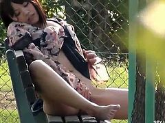 Sexy japanese babe shows off her sexy body outdoors. She spreads her legs wide and rubs her tight pussy for a nice teenage orgasm!