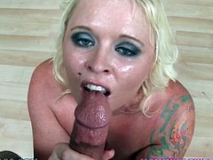 The horny and busty tattooed blonde MILF Angel Vain really knows how to please a cock as you can see in this hot POV video.