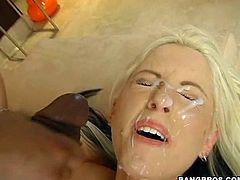 Get a load of this blonde babe's sexy body and especially her big round tits in this hardcore video where she's nailed by a black monster cock.