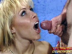 Amazing blonde is having her tight holes nailed in retro gangbang porn scene