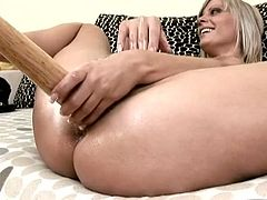 Wanton blond MILF is not afraid of big volumes. She takes a baseball bat to use it for fucking her soaking shaved cunt in arousing lesbian sex video by 21 Sextury.