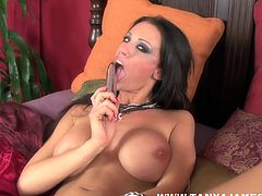 Big tits Tanya James likes sucking and sticking her toy in that warm pussy