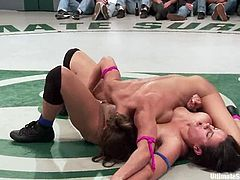 Brunette girls lick fight on the ring and then this battle slowly turns to a wild lesbian threesome. They lick and finger each others pussies with great pleasure.