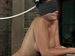 Lovely brunette girl fondles her pussy and gets toyed deep by the fucking machine. After that she gets blindfolded and whipped with a stick.