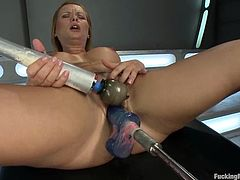 Curvaceous blonde girl pleases her vagina with a vibrator. After that she also gets her ass drilled by the fucking machine.
