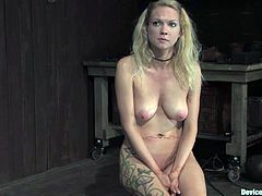 This girl enjoys rough BDSM action. She lies on the floor being chained. The guy also fixes special pumps to her tits. Then she also gets toyed with a vibrator.