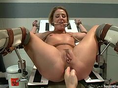 Sheena Shaw gets bounded by the doctor in prison hospital. She gives a blowjob and then gets her ass fingered. After that she gets fucked and facialed.