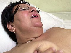 Bbw mature Mariette has a lot of love to give. She lays naked on her back and the guy's she's with shovels his face into her fat pussy. He eats her bald cunt and makes Mariette moan! After using his lips on her vagina he kisses her and thrust his hard penis in her juicy pussy. All her cunt needs now is some cum!