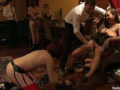 Tied up girls suck big dicks. After that the redhead girl lies down on a table and gets her pussy licked. Then she gets fucked by Black dude.