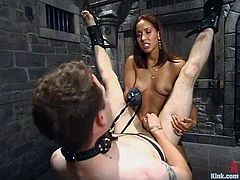 Kinky brunette mistress tortures her sex slave and gets her pussy licked by him. After that she fucks this guy with a strap-on.