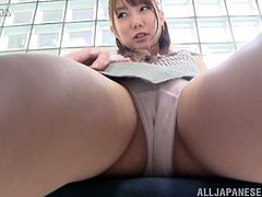 You will see an upskirt shot of a Japanese girl in skirt wearing pink panties for her day at the office.