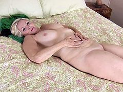 A dirty-ass cock sucker blonde fucking slut gets naked on bed and sticks fingers in her pussy till she fucking cums, hit play and check it out right here!