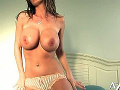 Nikki Benz got her favorite toy with her and sucks it deep down to the bottom. Then she spreads her long legs and sticks it in her horny pussy!