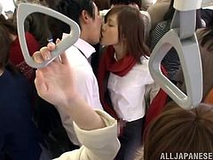 Sexy Japanese chick is getting naughty with some dude in a crowded bus. She makes out with the guy and then allows him to poke his dick deep into her mouth.