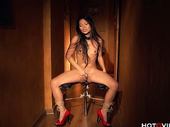 Lady Mai is bound to a chair, but her hands are free. She is using the Hot G Vibe to masturbate, squirting at the end.