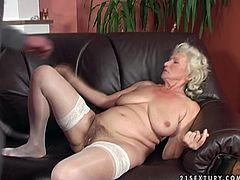 Ugly pale old bitch with droopy boobs gets her mature disgusting cunt eaten