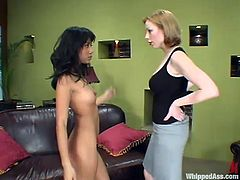 Adorable Latin babe stands on all fours getting her ass spanked by Adrianna. After wax session Nyomi gets pounded with a strap-on.