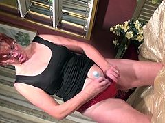 Iris K kneels on the bed in her satin blouse and panties and pulls out her favorite vibrator, which she uses to masturbate with. She likes to put on a show for you. She sucks on the vibrator and rubs it on her nipples before inserting it in her cunt.