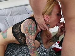 The tattooed MILF Sarah Jessie is one amazing cock sucker, and with those tattoos and big tits she's simply to hot to resist.
