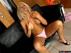 Steamy blond pornstar Stacy Silver in satin pink lingerie sits on the couch between two horny dudes that fingering her shaved punani before she bends down for a fuck in doggy style while giving a head in sultry threesome sex video by Pornstar.