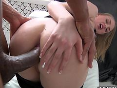Black cock penetrates hot beauty in the ass and makes her to scream and moan