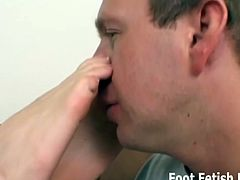 This blonde has her tiny toes sucked by this feet pervert. She touches her pussy when her feet are in his mouth.