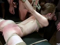 Pretty girl shows what a salacious bitch she is. She lets a few guys tie her up and then enjoys their dicks in her pussy.