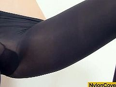 Check this slender and hot brunette belle covering herself with a lot of nylons before she's ready to make a hole in the crotch and dildo her pussy into a hell of an orgasm.