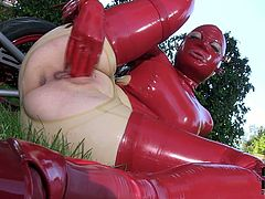 Sextractive BBW woman wearing rubber costume and mask is pleasing her sexual lust outdoor on a loan. Enjoy watching her fingering wet clam passionately.