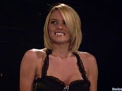 Busty blonde Krissy Lynn is having fun in a basement. She gets immobilized and moans loudly while getting her boobs pressed.