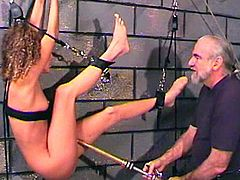 Young gal being punished by older dude during hot session of pure BDSM