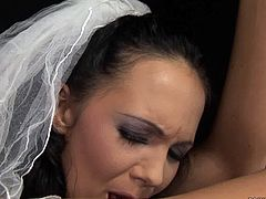 Kinky brunette bitch is fond of tough sex so she prefers BDSM games at her wedding night. Watch her getting her pussy lips stretched wide while hogtied in standing position.